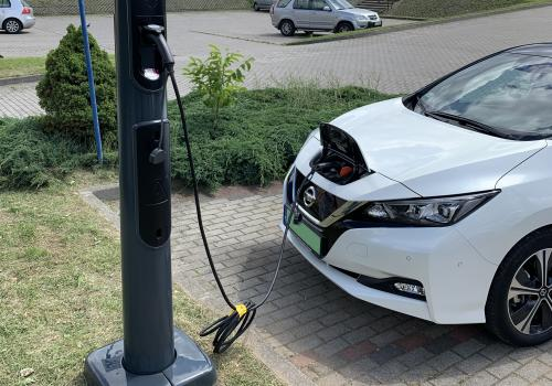 Electric vehicle charging stations at office and hotel parking lots, and fitness